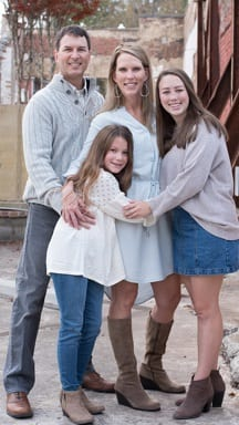 Embryo adoption parents Perry and Susan Lee with their daughters Olivia and Avery.