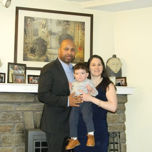 Embryo adoption parents Terrence and Christina Daniels with their son Grayson.