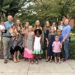 Embryo adoptions parents Brent and Elizabeth Blake and Justin and Stephanie Gerhart with their children.